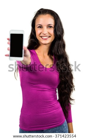 Smiling woman showing smartphone screen at the camera on white screen