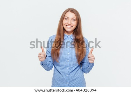 Smiling woman showing thumbs up isolated on a white background - stock photo