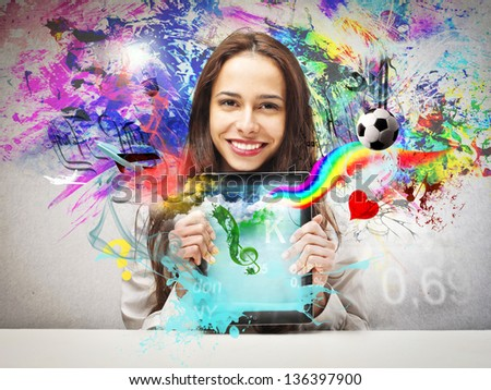 smiling woman shows tablet - stock photo