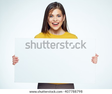 Smiling woman sign board holding. Girl showing banner with copy space.