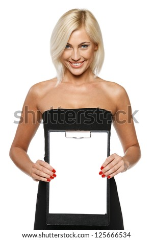 Smiling woman standing showing white paper clipboard, over white background