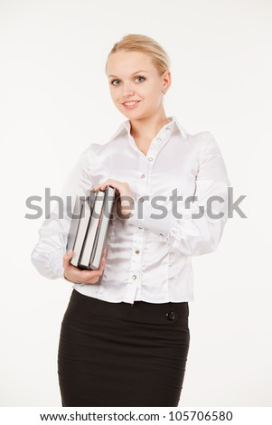 Smiling woman student with her books on white background.