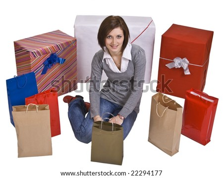 Smiling woman surrounded by a lot of gifts - stock photo
