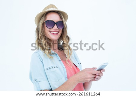 Smiling woman texting with her smartphone on white background - stock photo