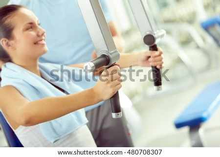Smiling woman training in gym