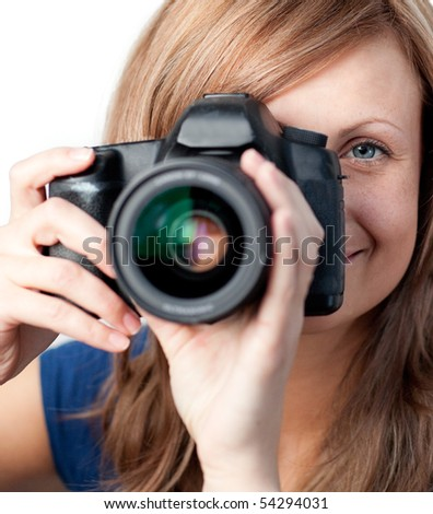Smiling woman using a camera against a white background