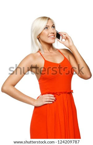 Smiling woman using cell phone looking up over white background