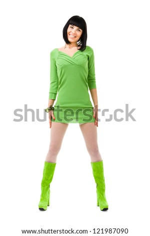 smiling woman wearing a green dress and green shoes on a isolated white background - stock photo
