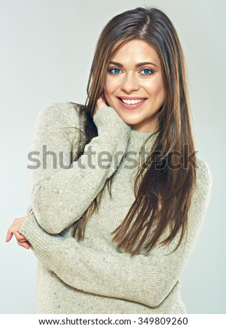 Smiling woman wearing sweater. Fashion portrait of casual dressed woman in warm clothes. - stock photo