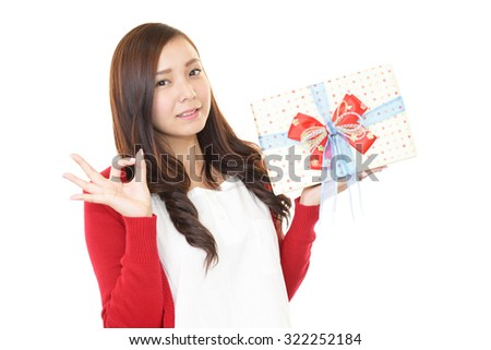 Smiling woman with a gift - stock photo