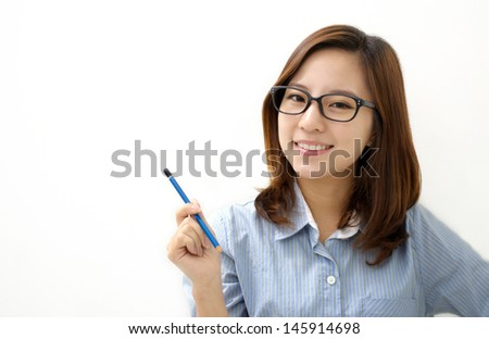 Smiling woman with a pen