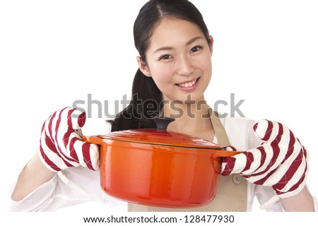 Smiling woman with a pot - stock photo