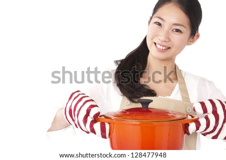 Smiling woman with a pot