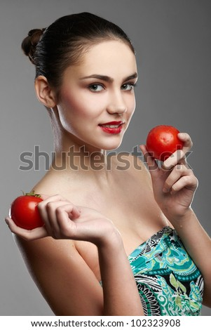 smiling woman with a tomatos in  hand