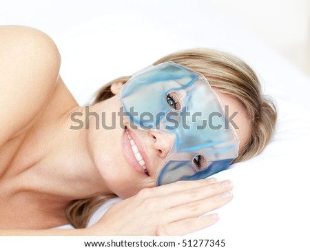 Smiling woman with an eye gel mask