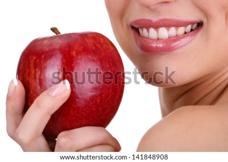 Smiling woman with apple isolated on white - stock photo