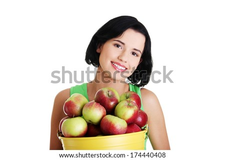 Smiling woman with apples , isolated on white  - stock photo