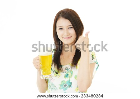 Smiling woman with beer