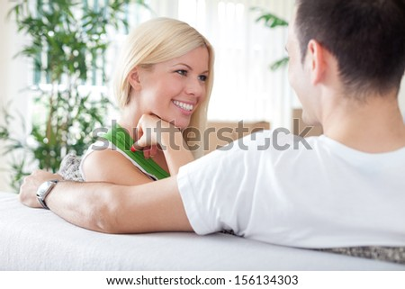 Smiling woman with boyfriend in new flat