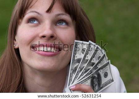 Smiling woman with cash - stock photo