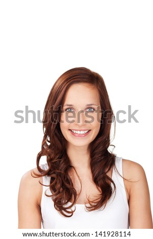 Smiling woman with curly hair posing over the white background - stock photo