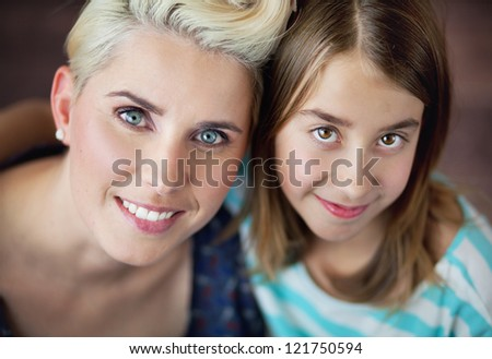 Smiling woman with daughter - stock photo