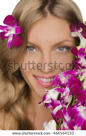 smiling woman with flowers isolated on white