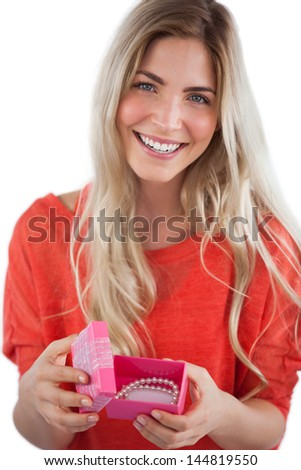 Smiling woman with gift box on a white background