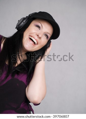 smiling woman with headphones listening music - stock photo