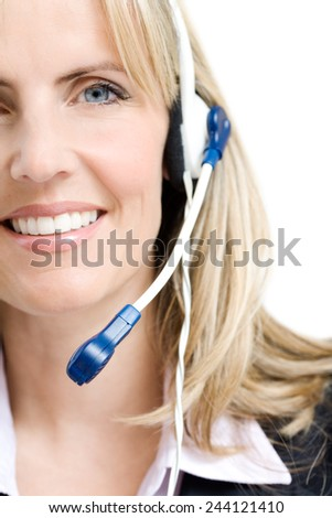 Smiling woman with headset. - stock photo