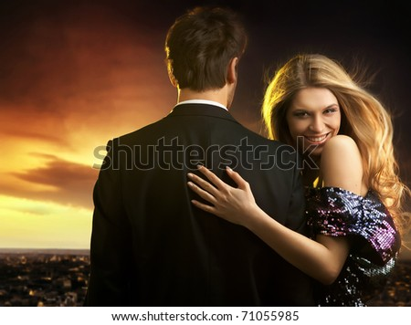 smiling woman with her husband - stock photo