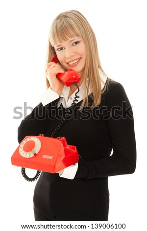 Smiling woman with old telephone isolated on white - stock photo
