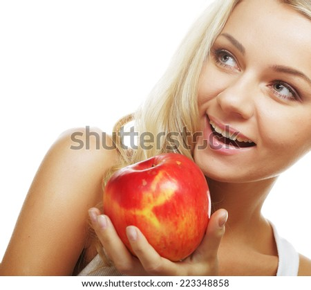 Smiling woman with red apple isolated on white