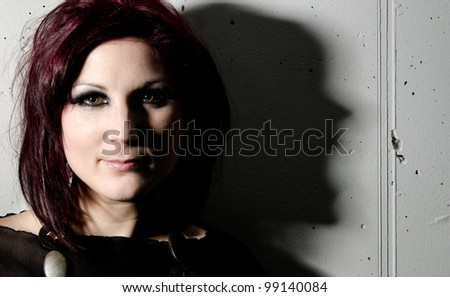 Smiling woman with screaming shadow - stock photo