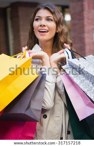 Smiling woman with shopping bags at the shopping mall