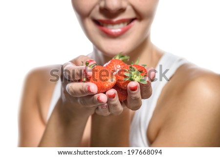 Smiling Woman with Strawberries in her Hand on white background.