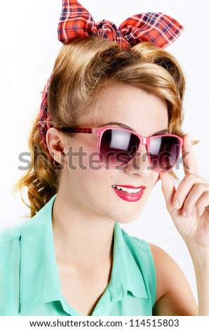 Smiling woman with sunglasses over white background