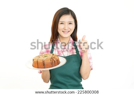 Smiling woman with sweets.