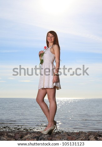 Smiling woman with tulip flowers sea travel