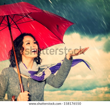 Smiling Woman with Umbrella over Autumn Rain Background. Laughing Healthy Girl outdoors. Bad Weather  - stock photo