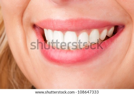 Smiling womans mouth with great white teeths