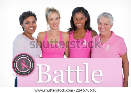Smiling women wearing pink tops and breast cancer ribbons against pink card - stock photo