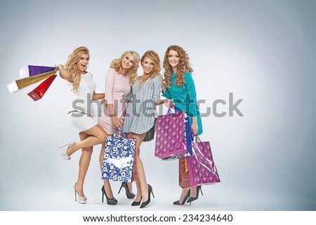 Smiling women with shopping bags - stock photo