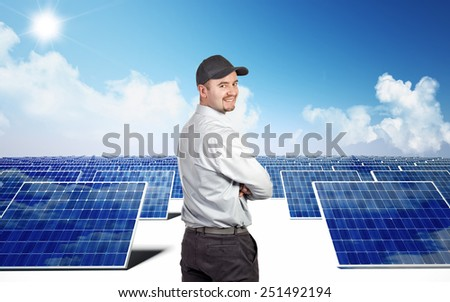 smiling worker and photovoltaic module - stock photo