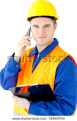 Smiling worker holding a clipboard talking on phone looking at the camera against white background