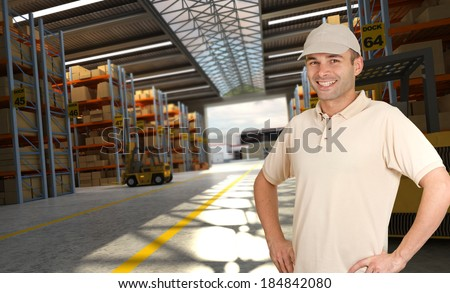 Smiling worker in a distribution warehouse - stock photo