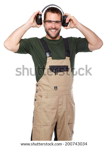 Smiling worker in brown uniform with protective earphones a glasses - stock photo