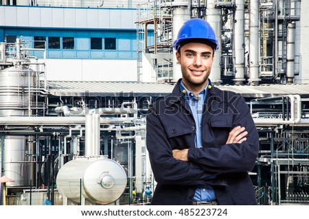 Smiling worker in front of a factory