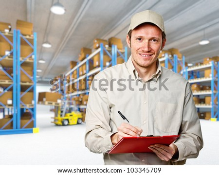 smiling worker in warehouse work place