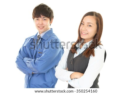 Smiling worker with business woman - stock photo